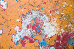 Abstract dirty background, concrete floor with old paint, grunge wall, red, blue, orange pieces of dried paint