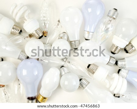 Abstract display of Assorted tungsten, florescent and halogen  light bulbs on a white background. Blue bulbs and white bulbs