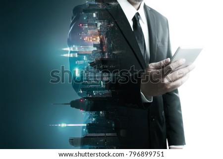Abstract double exposure image of businessman man using mobile smart phone mix with flip night creative city background . Always stay connected concept . ストックフォト ©