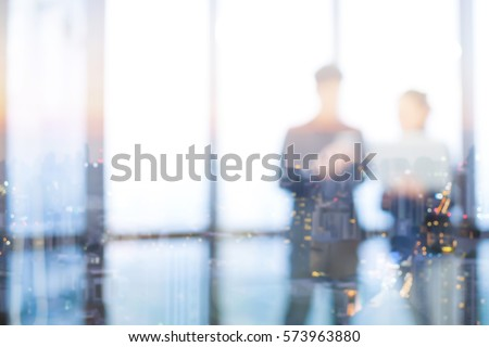 abstract double exposure night city with blurred two business people collaborate talk or plan about project or discussion somethings in meeting room for background.