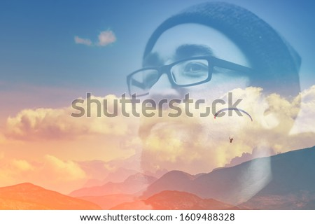 Abstract double multiply exposure head portrait of a hipster man beard mustache face in glasses outdoors on nature Parachute skydive psychology mindset power of mind, inner peace mental health concept