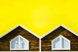 Abstract double triangle angled corner of building structure with yellow sky. Abstract color and design. Architectural detail and design. Isolated architecture detail. Abstract architecture detail