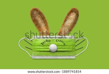 abstract easter rabbit with mask - german text frohe ostern on mask - means happy easter in english Stock foto ©