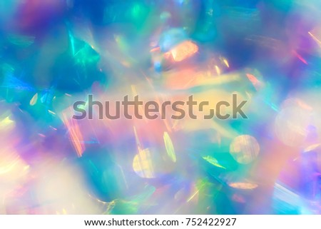 Abstract electro modern futuristic night club party texture background image of deep cosmic space nebula with vivid turquoise purple and yellow bokeh light gleaming effect and shiny bright neon glow