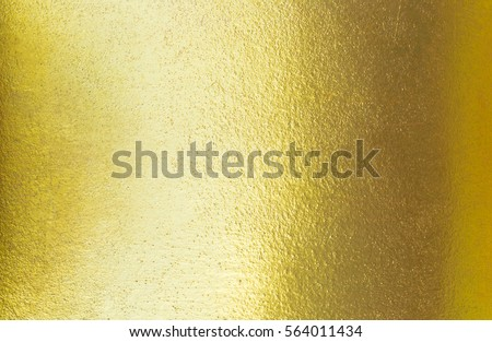 Abstract elegance gradient gold texture with light reflection, golden texture background and wallpaper #564011434