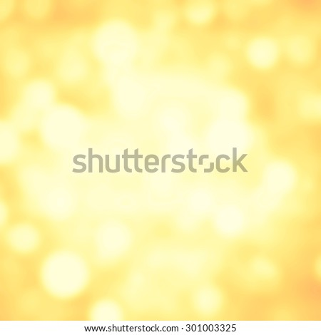 Abstract Festive background. Glitter vintage lights background with gold and white lights, defocused. Christmas and New Year feast bokeh background with copyspace.
