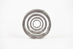 Abstract figure of concentric circles, created with photographs of pieces of metal tube by photo composition on a white background, tubes are normally used in construction.