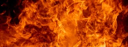 Abstract fire flame burn glowing on black dark background, yellow orange and red flame of fire pattern beautiful and hot power heat is danger