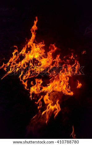 Abstract Fire flame on black background #410788780