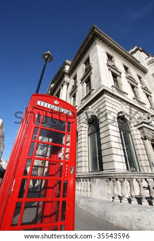 Abstract fish eye view - typical red London phone booth, symbol of Great Britain.