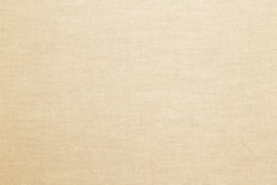Abstract flat bright cream tan colored fabric textile texture background.