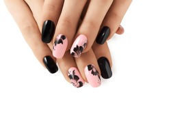 Abstract floral pattern on pink nails black.