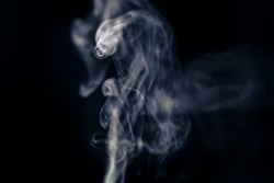 Abstract flowing steam of air humidifier with swirl and glowing dynamic tornado on black