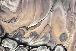 Abstract fluid art background light brown and black colors. Liquid marble. Acrylic painting on canvas with beige gradient and splash. Alcohol ink backdrop with wavy pattern. Stone section.