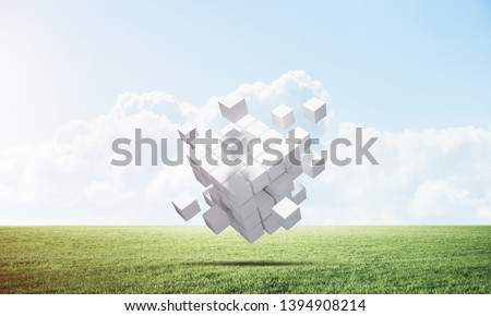 Abstract flying white cubes on green meadow. Virtual reality and digital technology. Hi-tech geometric composition. Nature landscape with green grass and blue sky. Mixed media with 3D rendering object #1394908214