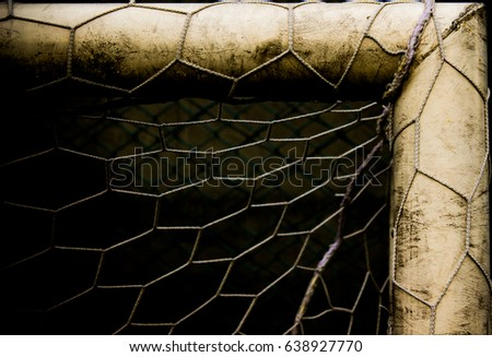 Abstract Football or soccer goal post and bar show old and dirty with goal net and black background. Space for text, Retro and classic, History football or soccer style concept. Vintage and dark tone.