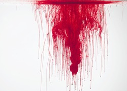 Abstract form of blood or red color in water, isolated on white background.