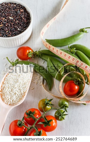 Abstract fresh organic vegetables with rice on white wooden. Food background. Healthy food from garden