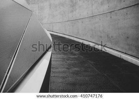 Abstract futuristic background. Diagonal lines, concrete and black asphalt.  #410747176