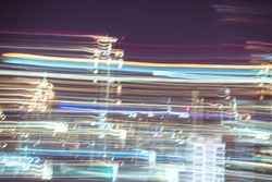 Abstract futuristic line night lights stripes in motion texture motion over dark ultra wide background. blurred lines moving fast