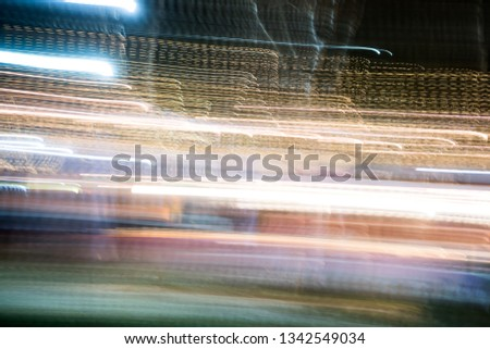 Abstract futuristic line night lights stripes in motion texture motion over dark ultra wide background. blurred lines moving fast #1342549034