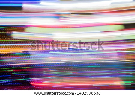 Abstract futuristic line night lights stripes in motion texture motion over dark ultra wide background. blurred lines moving fast #1402998638