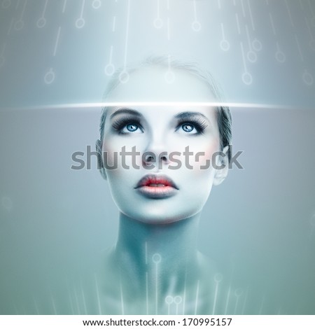 Stock Photo Abstract futuristic woman looking at data flow in a virtual display