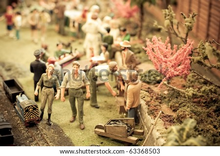abstract garden scene using miniature model figures and objects