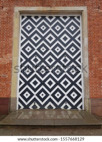 Abstract geometric door of an ancient building #1557668129
