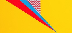 Abstract geometric fashion papers texture background in yellow, red, pink, blue colors. Top view, flat lay