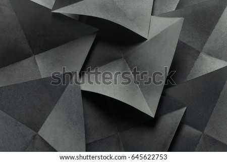 Abstract geometric of paper sheets folded in pyramidal shapes