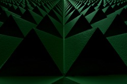 Abstract geometric pattern with lines formed by the apex of many triangular pyramids from soundproofing wall.Spatial geomatry, green volumetric polygonal pattern. Geometric abstract texture.Futuristic