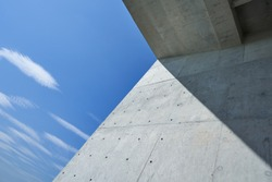 Abstract geometric view of modern building with blue sky .