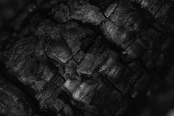Abstract geometrical pattern of Charcoal from burned wood in black and white - wood after a barbecue in the grill - texture, backdrop or wallpaper for photo montage