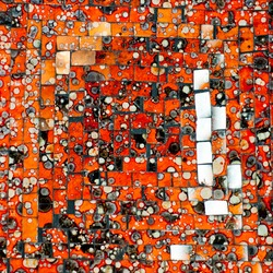 Abstract glass decorative mosaic background. Orange mosaic made by ceramic tiles with blots and stains.