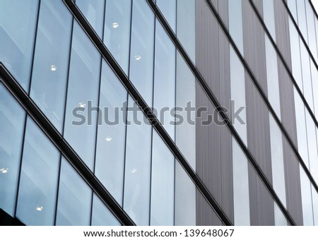 Abstract glass wall of office block; impersonal facade of city office block