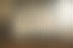Abstract glass with wire grid texture.