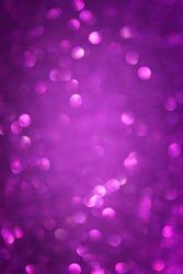 abstract glitter background of defocused purple lights