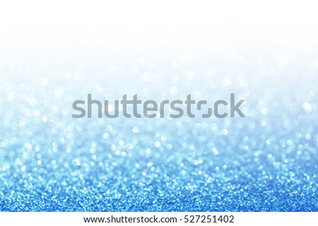 Abstract glitter blue background. Holiday shiny texture.