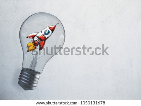 Abstract glowing lamp with drawn space ship. Startup and entrepreneurship texture. 3D Rendering