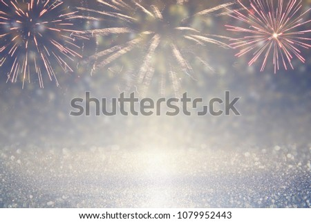 abstract gold and silver glitter background with fireworks. christmas eve, 4th of july holiday concept #1079952443