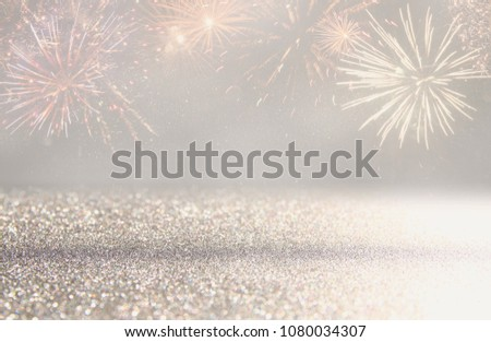 abstract gold and silver glitter background with fireworks. christmas eve, 4th of july holiday concept #1080034307