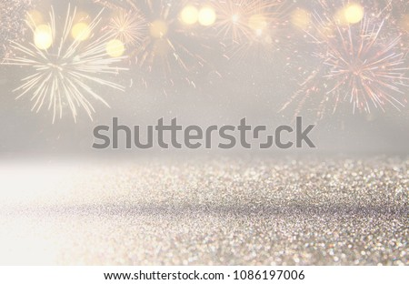 abstract gold and silver glitter background with fireworks. christmas eve, 4th of july holiday concept #1086197006