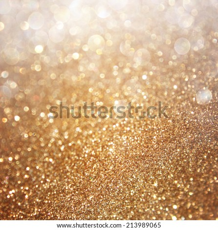 Abstract gold background with copy space . gliiter bokeh lights