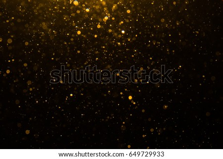 Abstract gold bokeh with black background #649729933