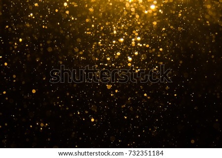 Abstract gold bokeh with black background #732351184