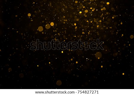 Abstract gold bokeh with black background - Shutterstock ID 754827271