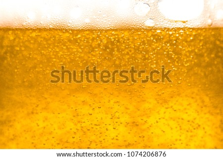 Abstract  gold color beer drink background, with white foaming buble texture, alcohol drink, pub and bar background concept