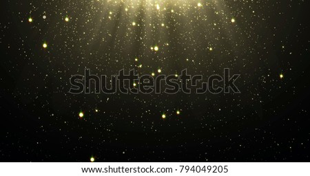 Abstract gold glitter particles background with shining stars falling down and light flare or glare overlay effect above for luxury premium product design template backdrop. Magic light radiance