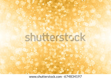 Abstract gold glitter sparkle confetti background or golden party invite for happy birthday, 50th anniversary, champagne color banner, New Year's Eve bash, Christmas blur, engagement or bridal texture